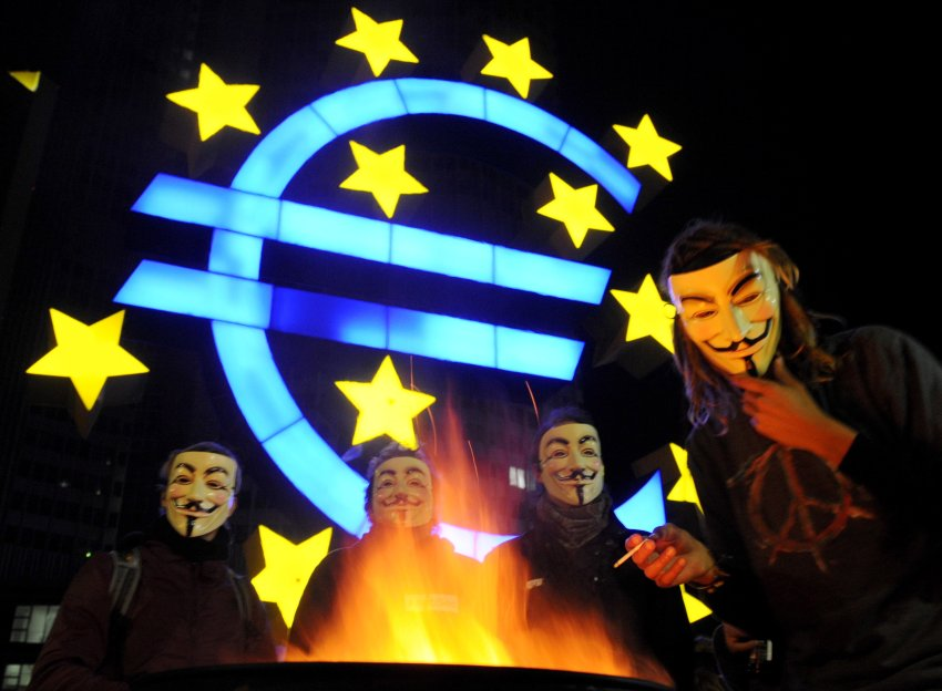 """Occupy Wall Street protesters in Frankfurt wearing masks from the movie """"V"""""""